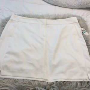 Golf skort with attached shorts. NWT